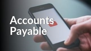 Hand holding phone with YouTube watching Accounts Payable