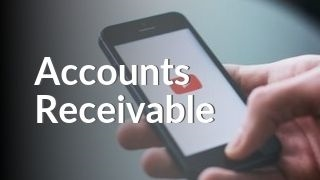 Hand holding phone with YouTube watching Accounts Receivable