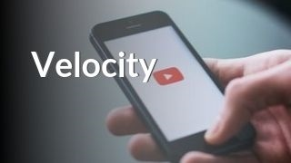 Hand holding phone with YouTube watching Velocity
