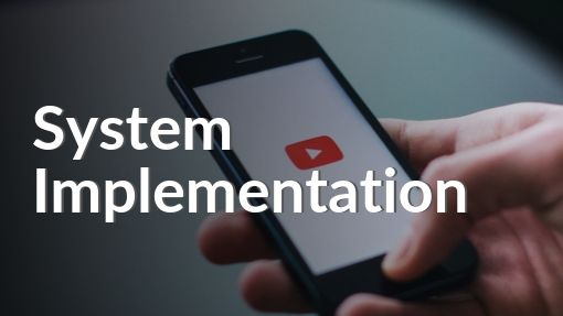 Hand holding phone with YouTube watching System Implementation